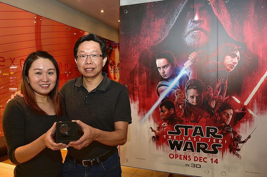 IT specialist Charles Poh and his daughter Celine were among 100 people who watched Star Wars: The Last Jedi, courtesy of The Straits Times yesterday, ahead of the movie's commercial opening today. Miss Poh also won a watch in a lucky draw.