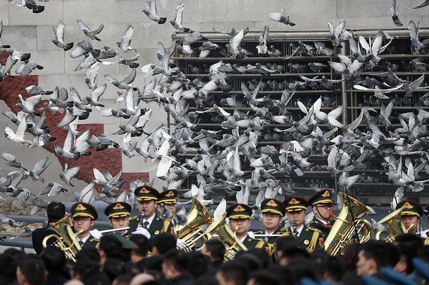 Birds being released during a ceremony in Beijing yesterday to mark the 80th anniversary of the Nanjing Massacre.
