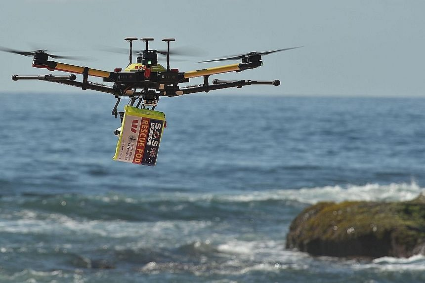 A shark-spotting drone with a safety flotation device attached flying over Bilgola beach north of Sydney. A drone camera captures thousands of images to develop an algorithm that can identify different ocean objects. The drones can spot sea creatures