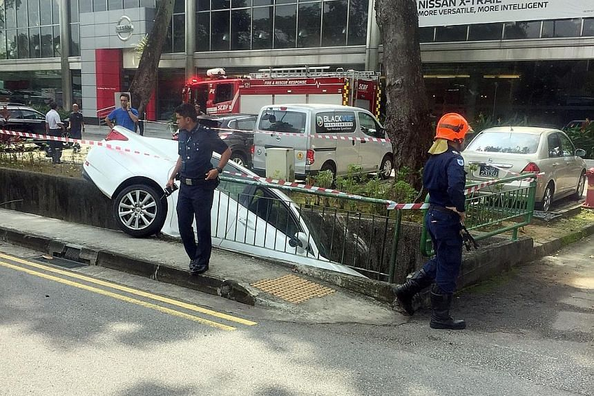 The 67-year-old driver of the white car was conscious when taken to National University Hospital. The police were alerted to the accident in Bukit Timah at 10.59am yesterday.