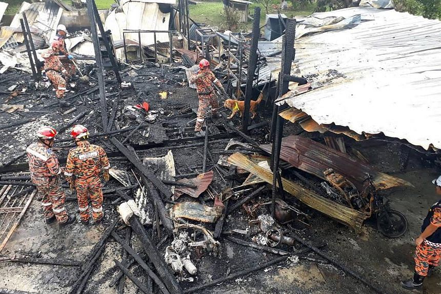 Four people died in a fire that destroyed their wooden house in Selangor. Initial investigations found that a flammable object had been thrown into the house and the family car had exploded.
