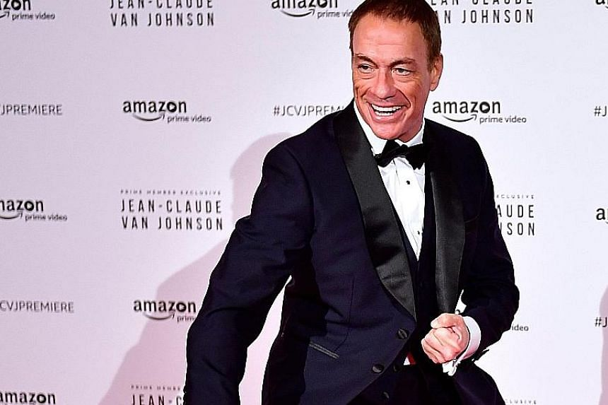 Action star Jean-Claude Van Damme shows off his martial arts moves at the world launch of his new Amazon series, Jean-Claude Van Johnson, on Tuesday in Paris. In the show, he sends up his image as the washed-up Muscles from Brussels, by playing a bro