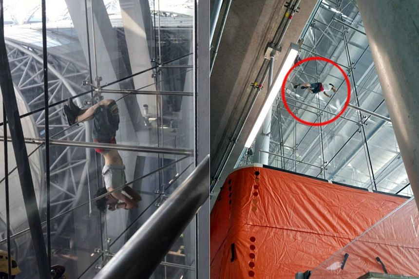 The woman reportedly climbed onto structural steel cables inside the airport, and then spent the next two hours dangling precariously from up to 20m in the air.