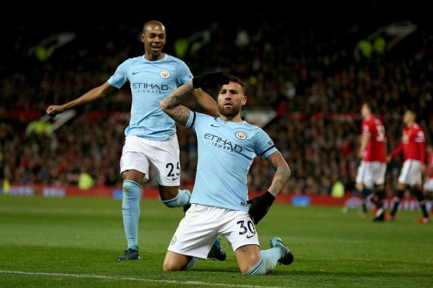 Manchester City's Nicolas Otamendi (right) celebrates scoring during the English premier league soccer match between Manchester united and Manchester City at Old Trafford Stadium in Manchester, Britain on Dec 10, 2017.