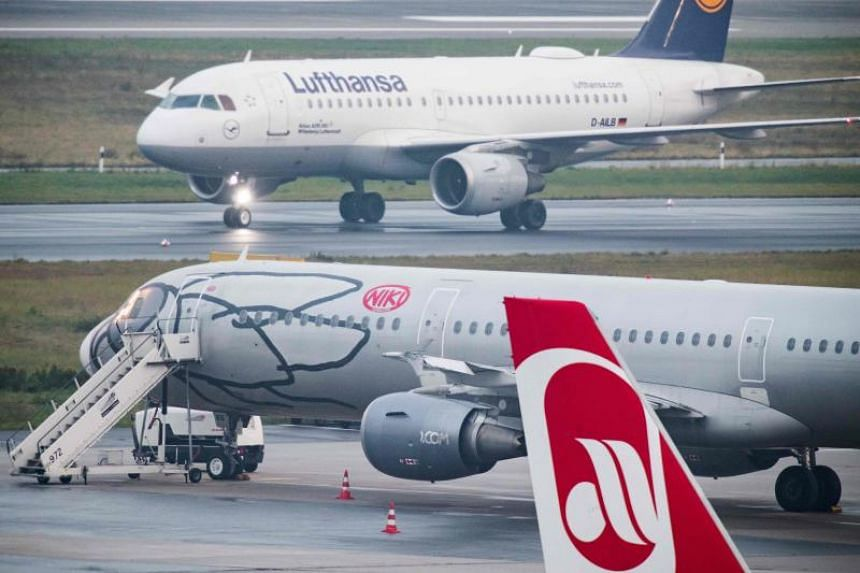 German airline Lufthansa rolls past Austrian airline Niki at the airport in Duesseldorf, western Germany.
