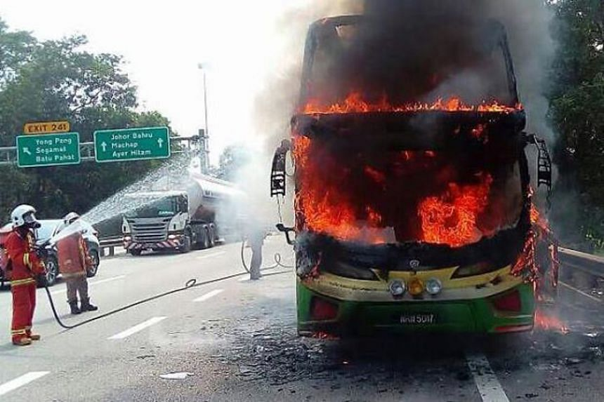 The fire engulfed the tour coach along along the North-South Expressway near Yong Peng.