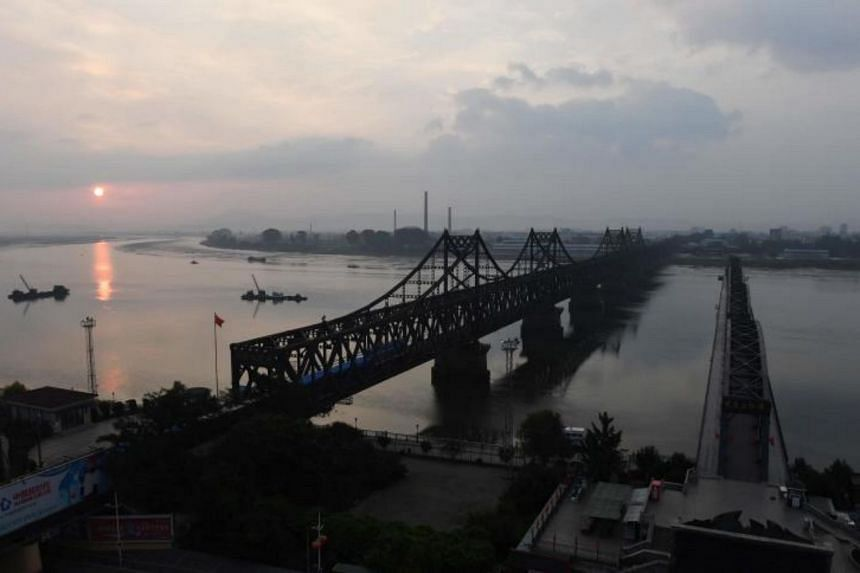 The Friendship Bridge (left) and Broken Bridge (right) which lead to North Korea, seen from Dandong, China, on Sept 5, 2017.