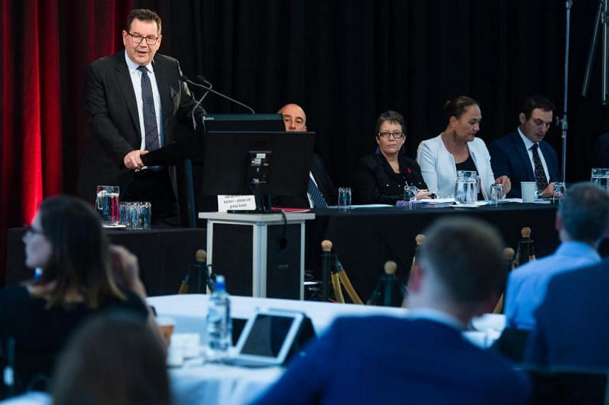New Zealand's Finance Minister Grant Robertson said the government expects to post a slightly lower-than-forecast Budget surplus in 2018 as it pours money into housing and social services.
