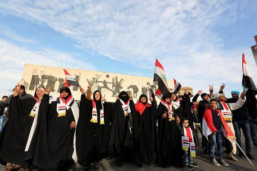Iraqis celebrate the defeat of the Islamic State in Iraq and Syria in Baghdad on Dec 10, 2017.