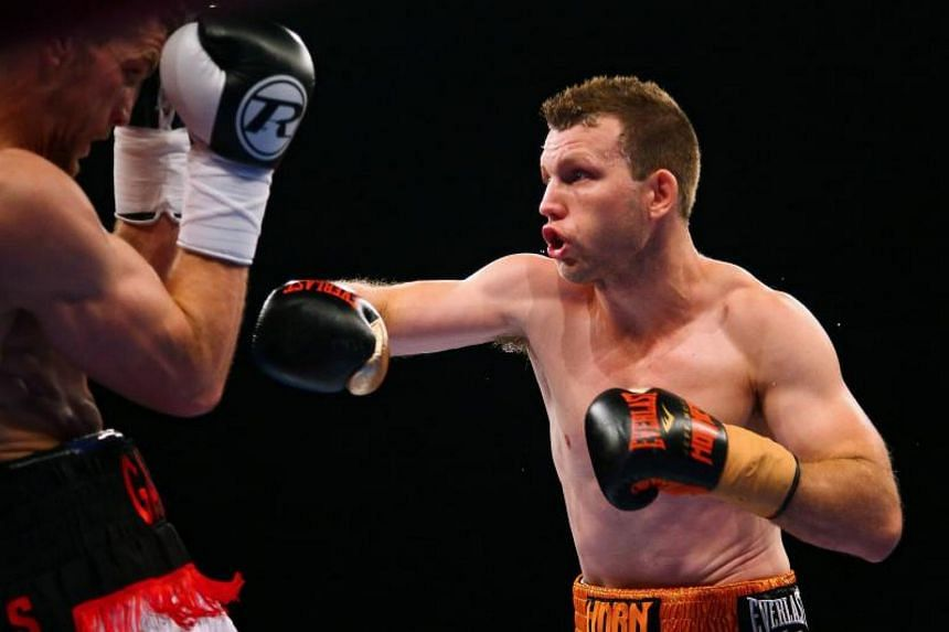 Australian boxer Jeff Horn (right) and English boxer Gary Corcoran (left) fight during their World Boxing Organisation welterweight title bout at Brisbane Convention Centre on Dec 13, 2017.