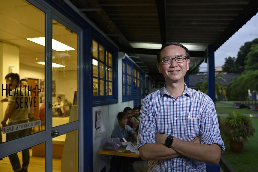 Dr Goh Wei Leong outside the Healthserve clinic at 1, Lorong 23 Geylang, which provides low-cost healthcare to migrant workers.