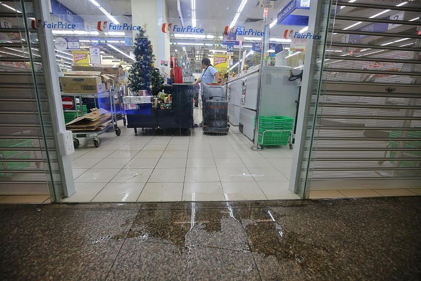 A pipe burst in the basement of the NTUC FairPrice outlet in Toa Payoh Central, causing water to spray down on customers and staff, and disrupting the supermarket's operations, on Dec 14, 2017.