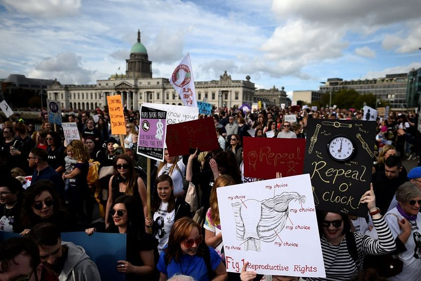 Demonstrators hold posters as they march for more liberal Irish abortion laws, in Dublin, Ireland on Sept 30, 2017.