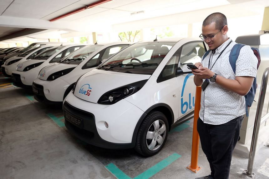 ST journalist Ahmad Zhaki Abdullah tries the BlueSg electric car sharing programme a day after its launch in Singapore on Dec 13, 2017.