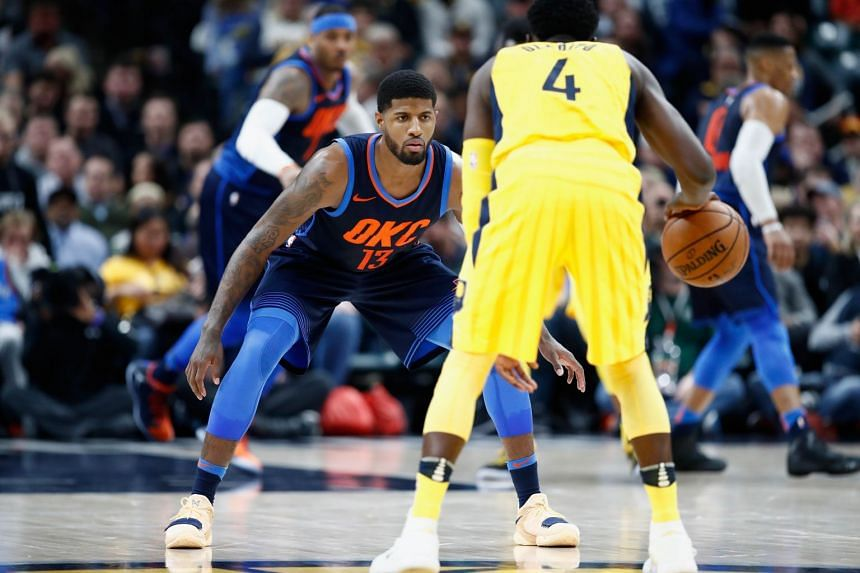 Paul George (in blue) of the Oklahoma City Thunder defends Victor Oladipo of Indiana Pacers during the game at Bankers Life Fieldhouse.