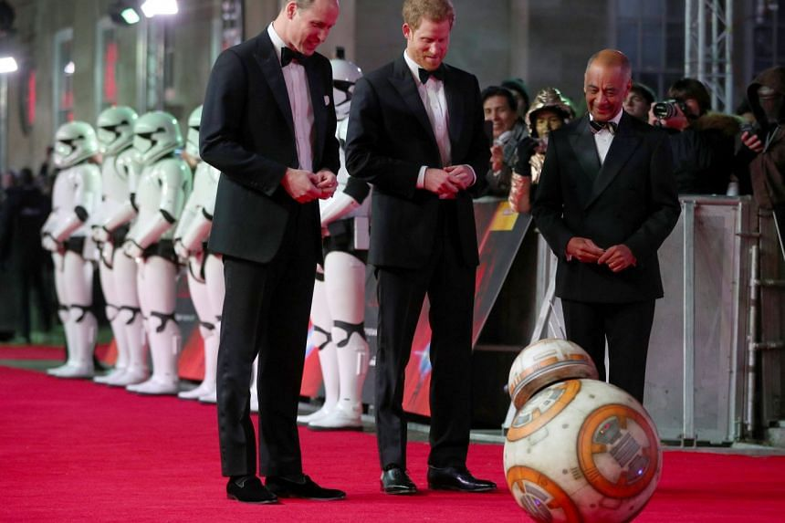 Britain's Prince William (left) and Prince Harry (centre) at the European premiere of Star Wars: The Last Jedi, at the Royal Albert Hall in central London, Britain, on Tuesday.