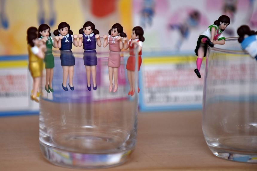 "The capsule toy craze took off in 2012 when the ""Koppu no Fuchico"" series (above), featuring figurines of women designed to hang over the edge of  a glass, gained a following among adults."