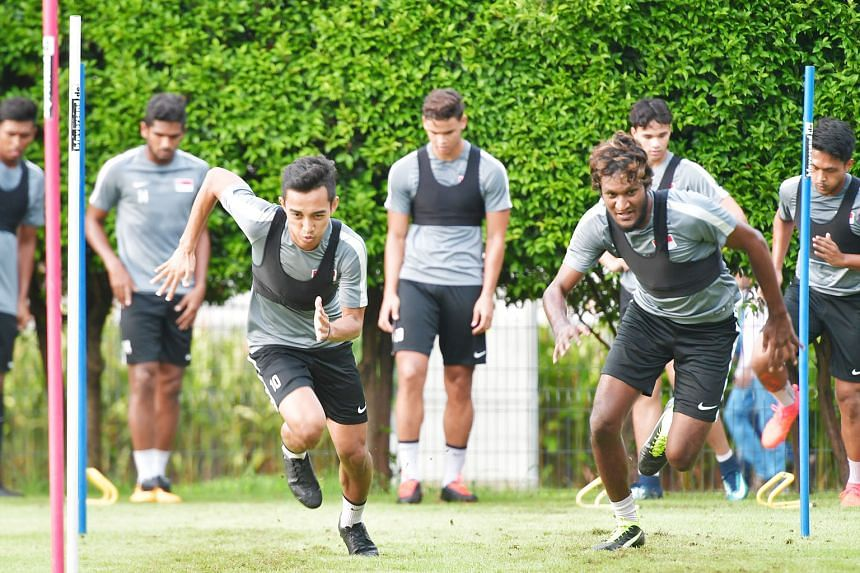 Faris Ramli and Madhu Mohana going through their paces at national team training last month. The Lions conceded late goals in international games recently and improving players' fitness is a key pillar of the FAS' revamp of the domestic league.