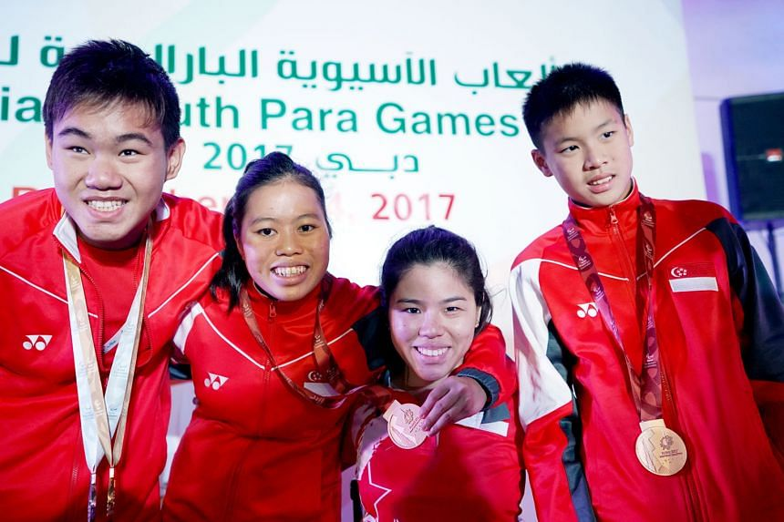 Left: Games chef de mission Yip Pin Xiu (second from right) with para-swimmers (from far left) Wong Zhi Wei (three golds, two silvers), Danielle Moi (two silvers, one bronze), and Colin Soon (two bronzes). Below: Para-sprinter Lionel Toh won his firs