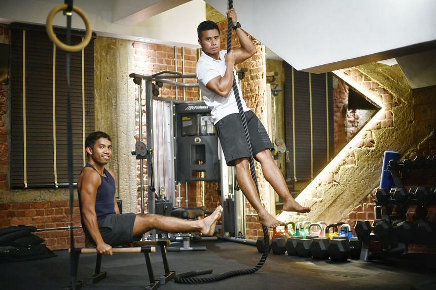 PushPullGive, founded in February, runs paid fitness sessions for the public, like a calisthenics session at Tiong Bahru Park (above), and for corporates, like bootcamp sessions (top), then pumps the proceeds into free sessions for marginalised young