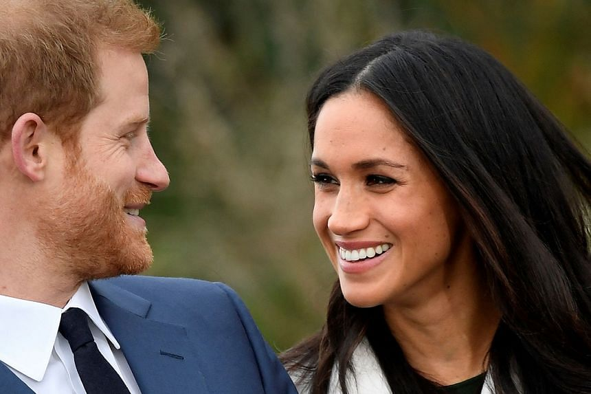 Britain's Prince Harry poses with Markle at Kensington Palace, London, on Nov 27, 2017.
