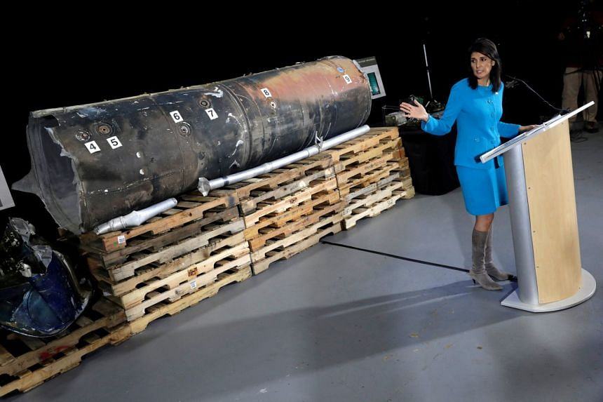"US Ambassador to the United Nations Nikki Haley briefs the media in front of remains of Iranian ""Qiam"" ballistic missile provided by Pentagon on Dec 14, 2017."