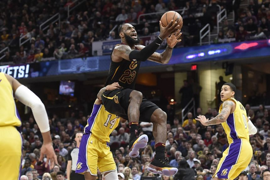 Cleveland Cavaliers forward LeBron James scored 25 points with 12 rebounds and 12 assists for the 59th triple-double of his 15-season career.