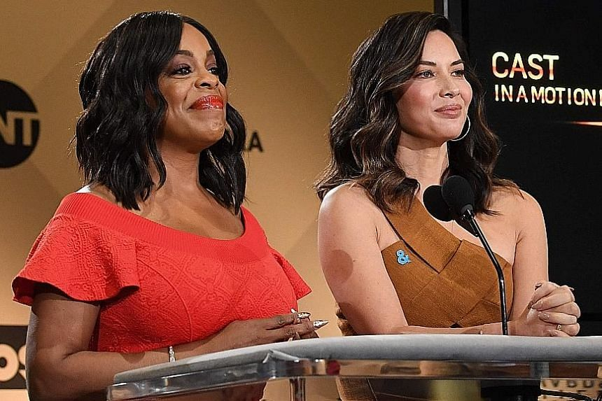 Actresses Niecy Nash (left) and Olivia Munn announce The Big Sick during the Screen Actors Guild Awards nominations on Wednesday.