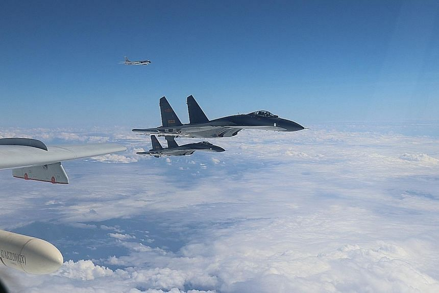 """Chinese jets carrying out """"island encirclement patrols"""" around Taiwan on Monday. Taiwan called the rise in China's military deployments irresponsible."""