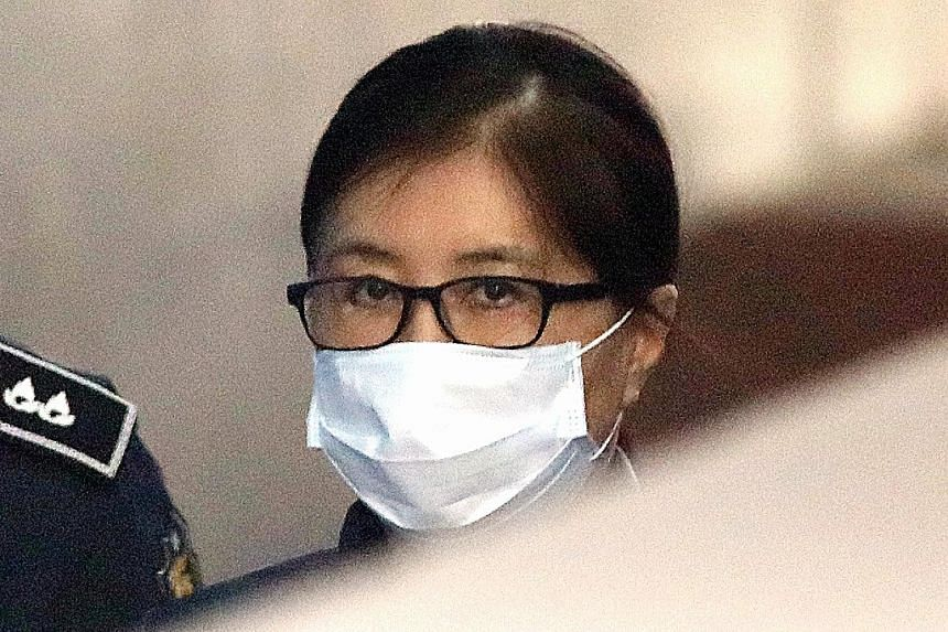 Choi Soon Sil arriving at the Seoul Central District Court yesterday. She is accused of colluding with ousted president Park Geun Hye to extort millions from conglomerates and using her links with Park to meddle in state affairs.