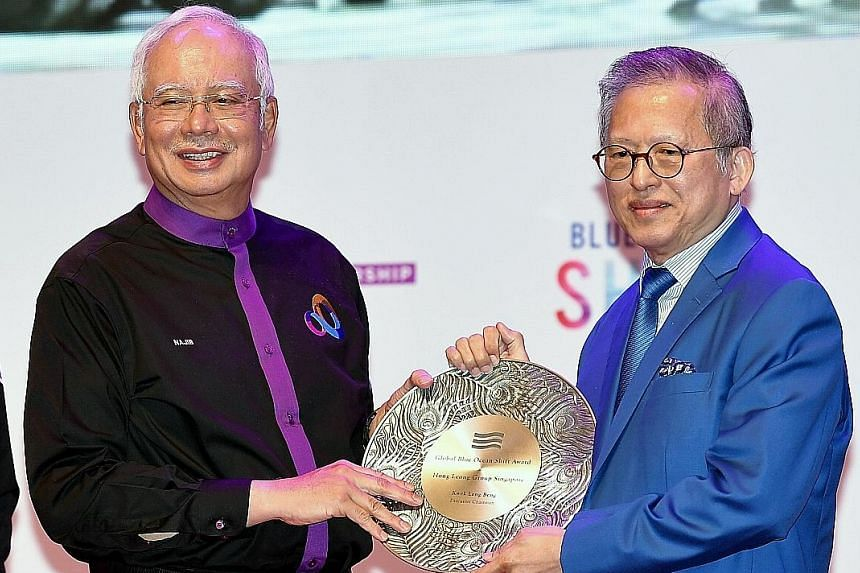 Mr Kwek Leng Beng receiving the Global Blue Ocean Shift Award for his efforts from Malaysian Prime Minister Najib Razak at the Global Entrepreneurship Community Summit in Kuala Lumpur on Wednesday.