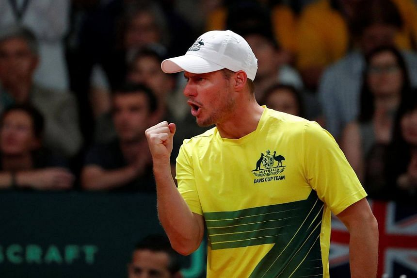 Lleyton Hewitt celebrates during the match between Belgium's Steve Darcis and Australia's Jordan Thompson at the Davis Cup semi-finals on Sept 17, 2017.