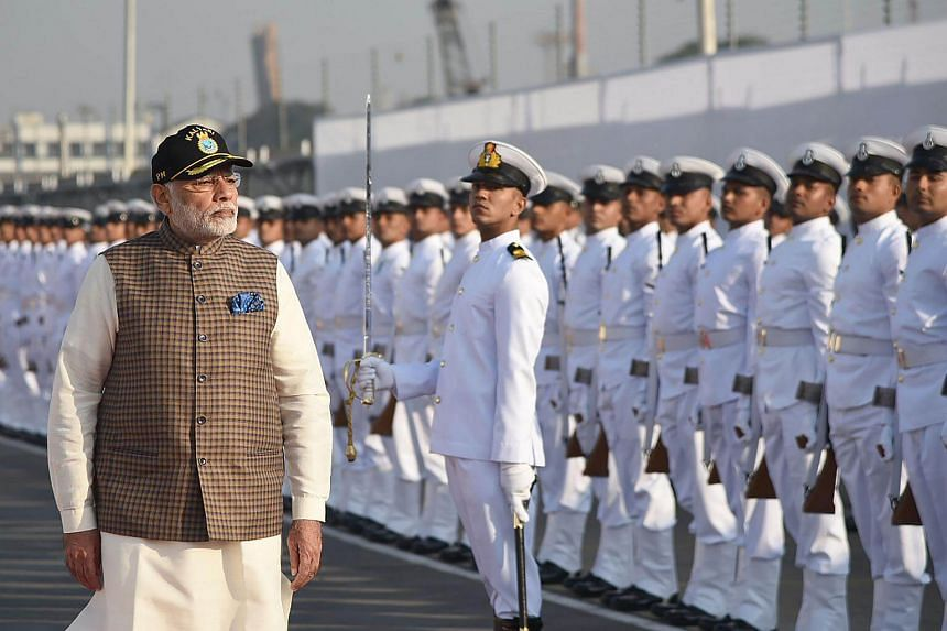 PM Narendra Modi inspecting a guard of honour during an event to commission the INS Kalvari Scorpene-class submarine, on Dec 14.