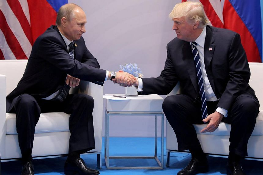 US President Donald Trump shakes hands with Russia's President Vladimir Putin during their bilateral meeting at the G20 summit in Germany on July 7, 2017.