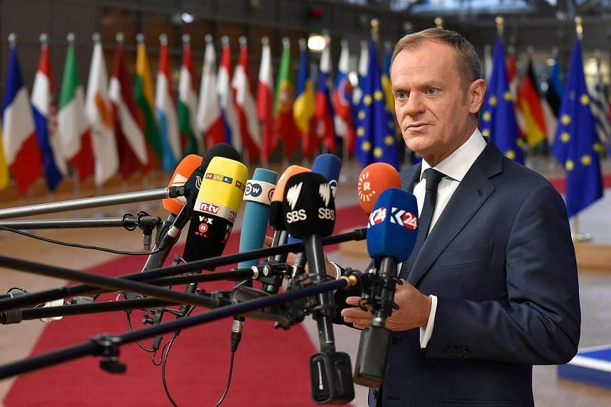 European Council President Donald Tusk answers the press on the first day of a European council meeting in Brussels, on Dec 14, 2017.