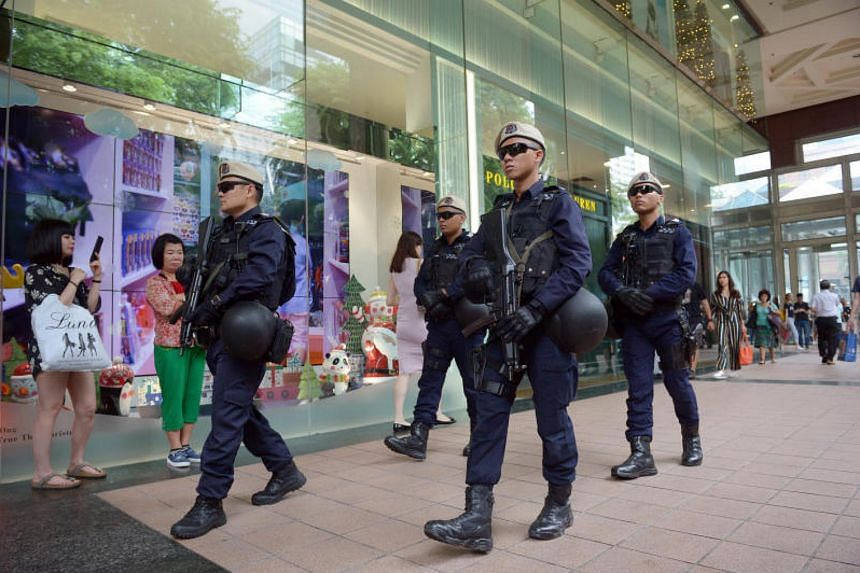Singapore Police Force's In-situ Reaction Teams from the Protective Security Command patrol around Ngee Ann City shopping complex in Orchard Road on Dec 15, 2017.