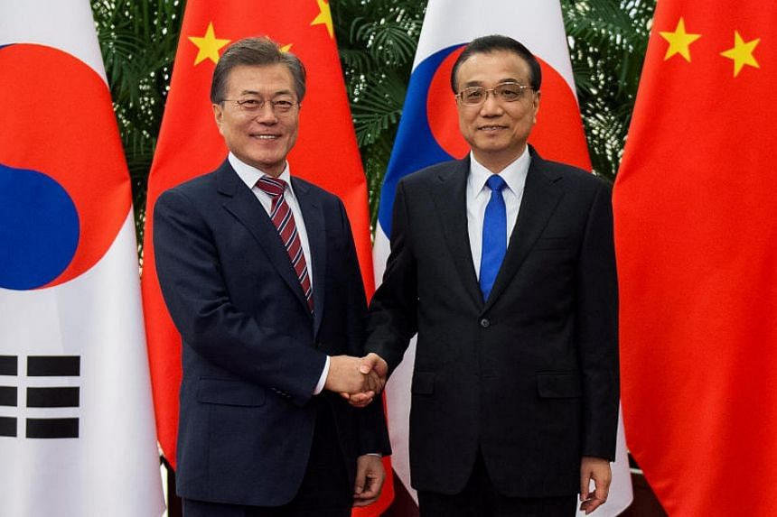 South Korean president Moon Jae-In and Chinese premier Li Keqiang at the Great Hall of the People in Beijing on Dec 15, 2017.