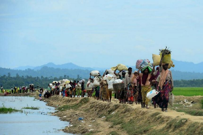 Rohingya refugees walking near the no man's land area between Bangladesh and Myanmar, in the Palongkhali area next to Ukhia, on Oct 19, 2017.