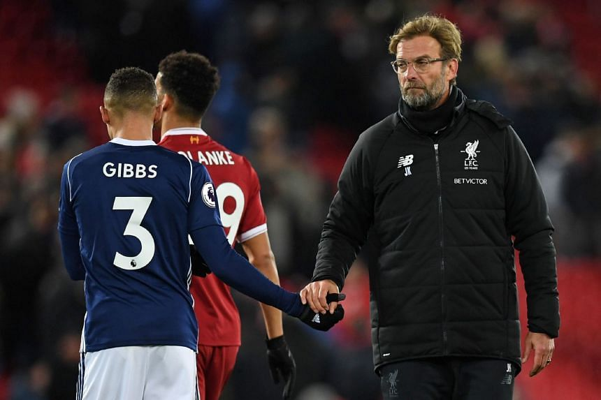 Klopp shakes hands with West Brom's Kieran Gibbs after a goalless draw, Dec 13, 2017.