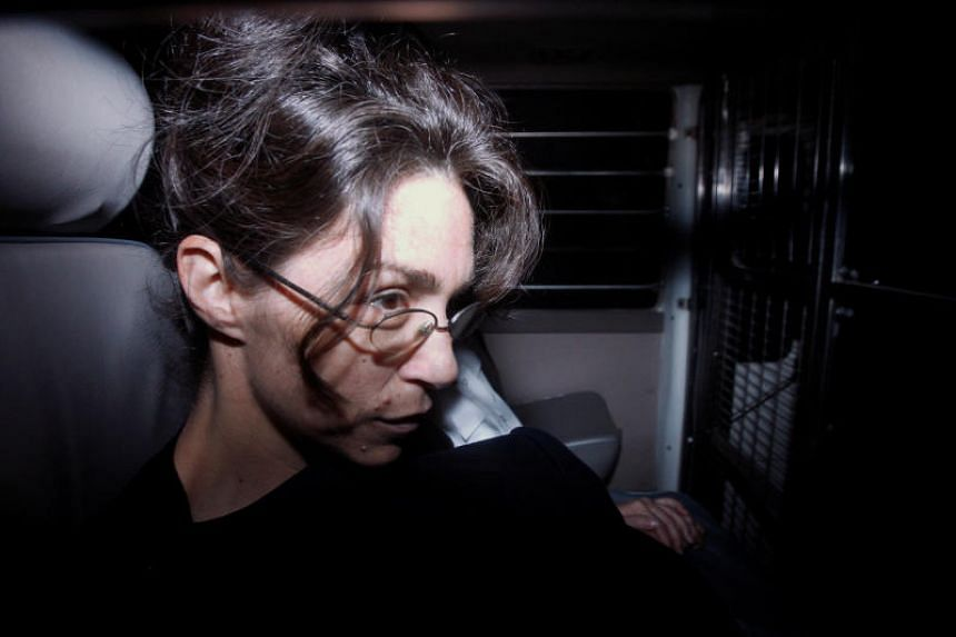 "Nancy Kissel, dubbed the ""milkshake"" murderess, sits in a prison van as she arrives at the Court of Final Appeal in Hong Kong on Feb 11, 2010."