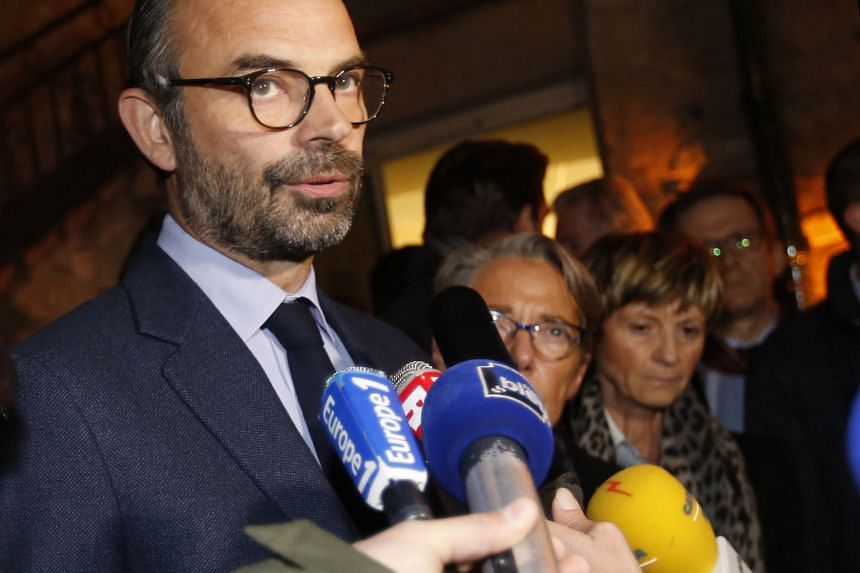 French Prime Minister Edouard Philippe makes a statement during a visit to the site of the accident.