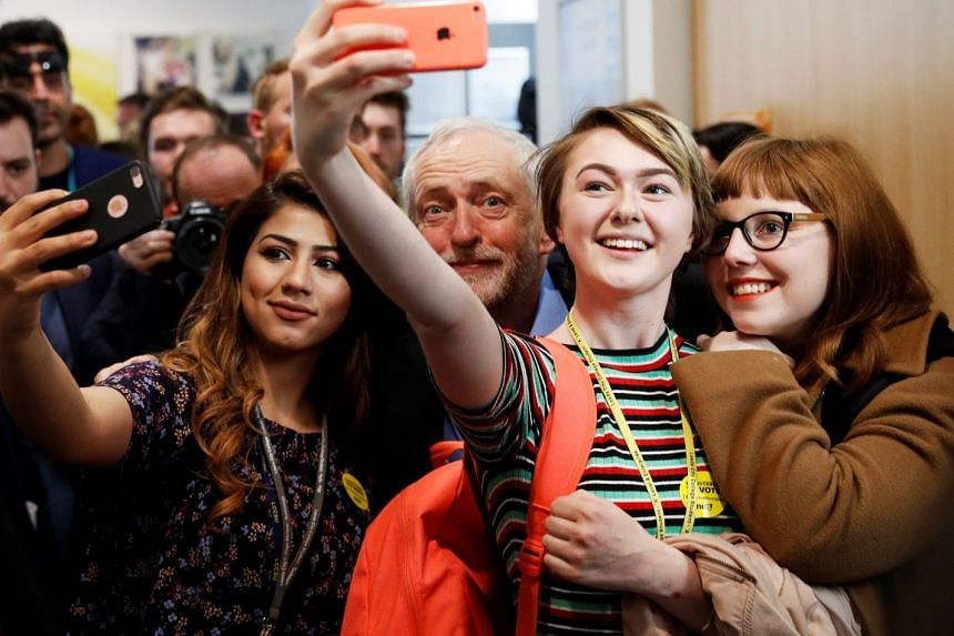 Young voters take selfies with Jeremy Corbyn, Britain's opposition Labour Party leader, at a campaign event in Leeds, on May 10, 2017.