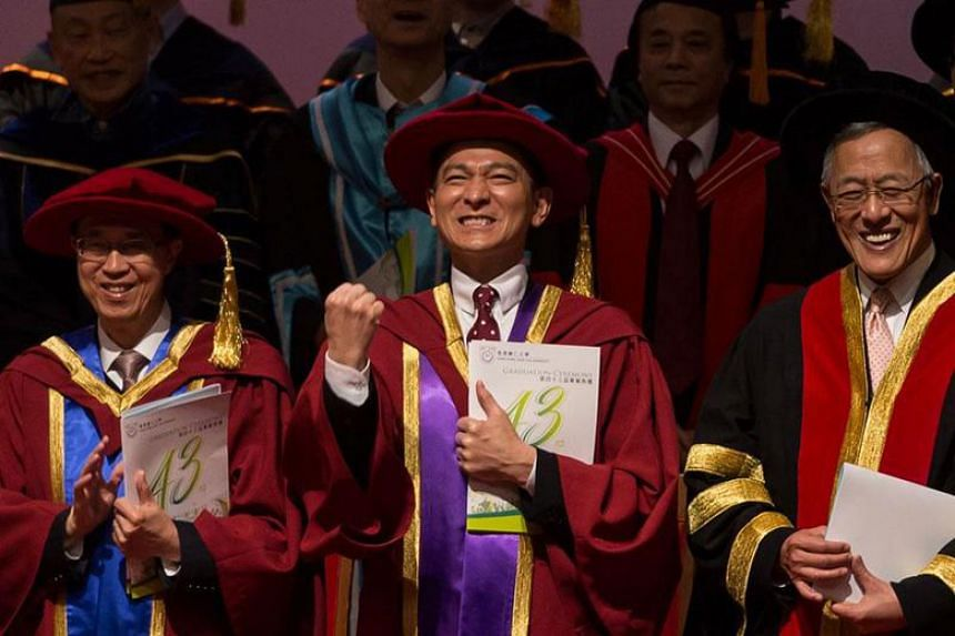 Andy Lau receives his honorary Doctor of Letters at the 43rd graduation ceremony of the Hong Kong Shue Yan University on Dec 14, 2017.