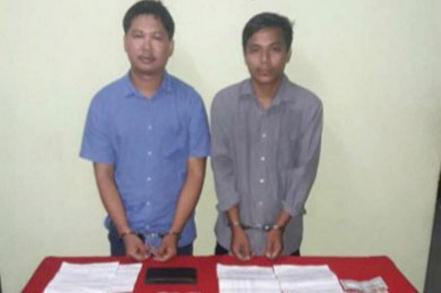 Reuters journalists, Wa Lone (left) and Kyaw Soe Oo, seen in a photo released by the Myanmar Ministry of Information on Dec 13, 2017.
