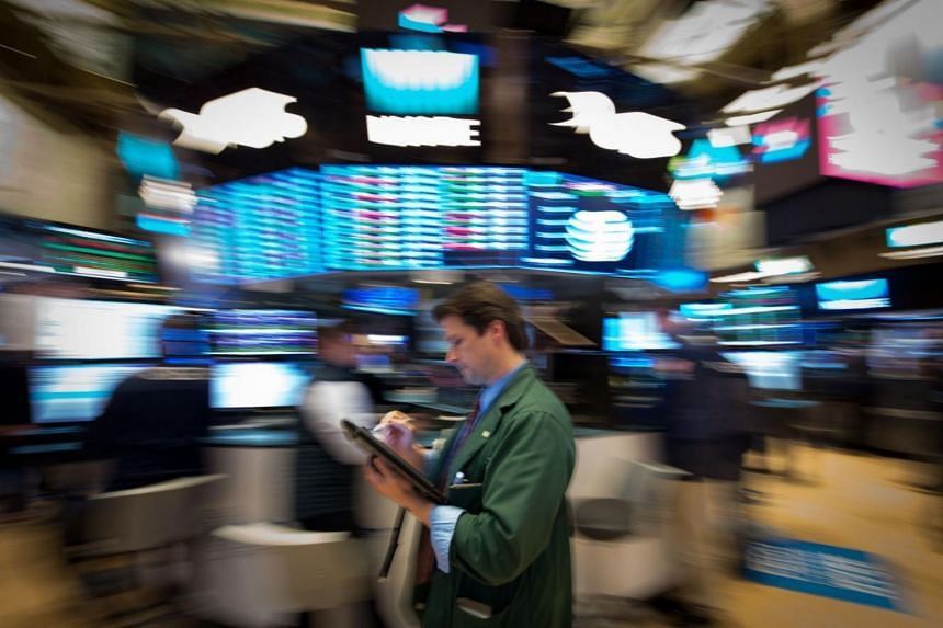 A trader works on the floor at the closing bell of the Dow Industrial Average at the New York Stock Exchange.