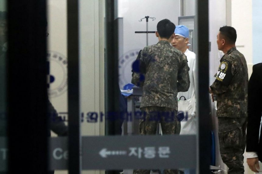 A South Korean soldier talks with a surgeon at a hospital where the North Korean soldier who defected to the South after being shot and wounded was warded prior to the transfer.