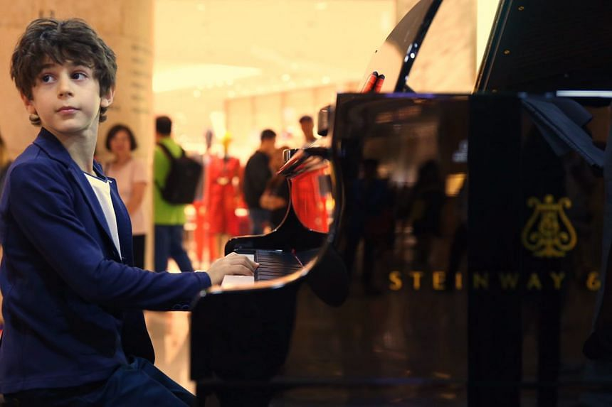 Jesse Collins, 11, playis his own composition, a Boogie Woogie improvisation, for the Piano Marathon 2017 at Ion Orchard.