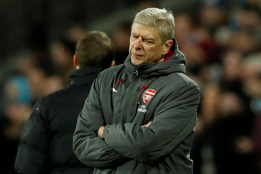 Wenger (above) said his players felt hard done by in not even garnering a point against United.