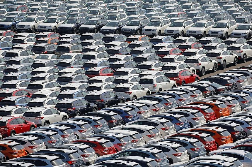 Newly manufactured Subaru cars await export in a port in Yokohama, Japan. The improved business confidence is a sign that Japan's economy is gathering momentum from robust exports and booming corporate profits.
