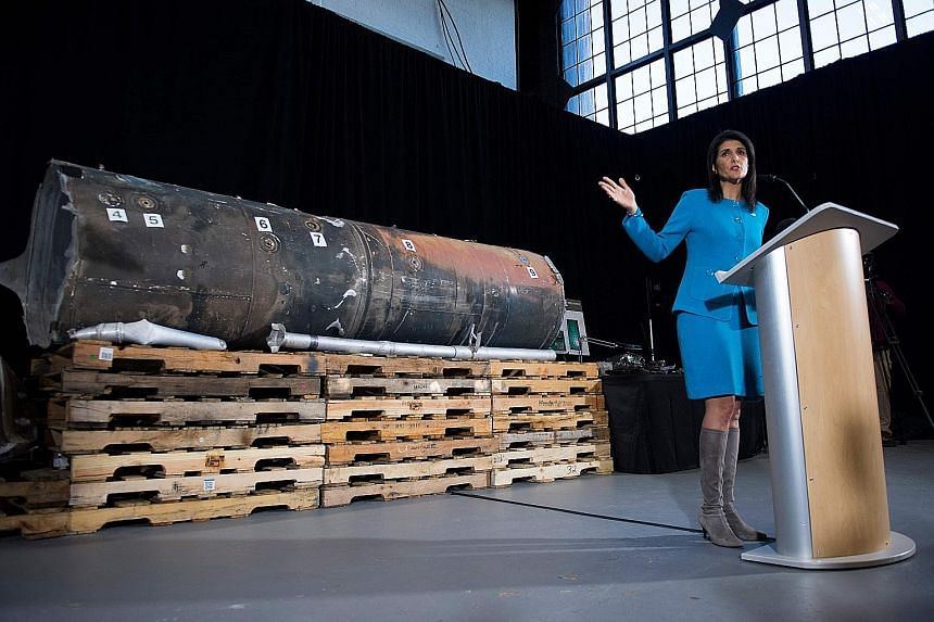 Ms Nikki Haley unveiling a recovered missile that the US says was made in Iran and fired by Houthi militants at Saudi Arabia last month.